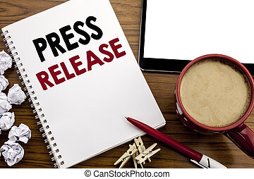 Conceptual hand writing text caption inspiration showing Press Release. Business concept for Statement Announcement Message written on notepad note paper on the wood table with coffee in office