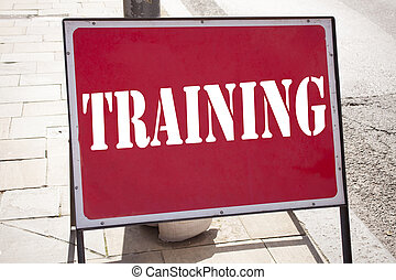 Conceptual hand writing text caption inspiration showing Training. Business concept for Education Text knowledge study written on announcement road sign with background and copy space