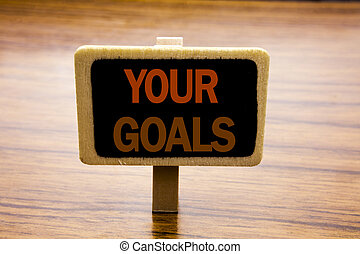 Conceptual hand writing text caption inspiration showing Your Golas. Business concept for Goal Achievement written on announcement board on the wooden wood background.