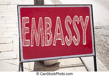 Conceptual hand writing text caption inspiration showing Embassy. Business concept for Tourist Visa Application written on announcement road sign with background and copy space
