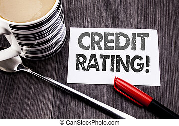 Conceptual hand writing text caption showing Credit Rating. Business concept for Finance Score History written on sticky note paper on the wooden wood background. With coffee and marker