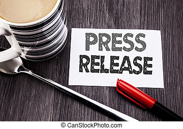 Conceptual hand writing text caption showing Press Release. Business concept for Statement Announcement Message written on sticky note paper on the wooden wood background. With coffee and marker