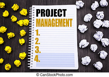 Conceptual hand writing text caption showing Project Management. Business concept for Strategy Plan Goals Written on notepad note notebook book wooden background with sticky folded yellow and white
