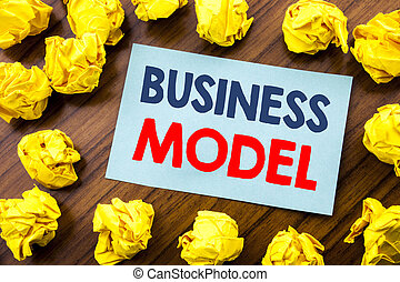 Conceptual hand writing text inspiration showing Business Model. Business concept for Solution Strategy Plan written on sticky note paper on the wooden background with folded yellow paper
