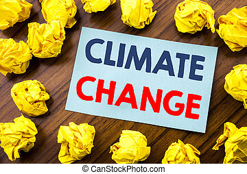 Conceptual hand writing text inspiration showing Climate Change. Business concept for Global Planet Warming written on sticky note paper on the wooden background with folded yellow paper