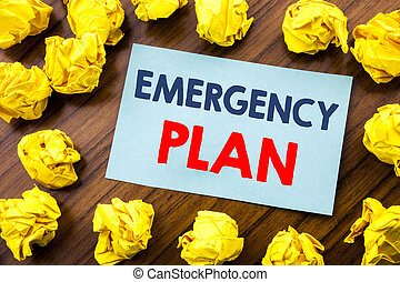 Conceptual hand writing text inspiration showing Emergency Plan. Business concept for Disaster Protection written on sticky note paper on the wooden background with folded yellow paper