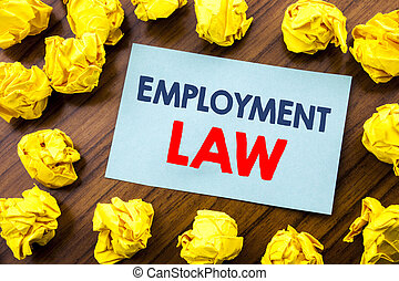 Conceptual hand writing text inspiration showing Employment Law. Business concept for Employee Legal Justice written on sticky note paper on the wooden background with folded yellow paper