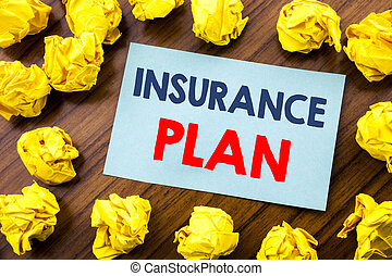 Conceptual hand writing text inspiration showing Insurance Plan. Business concept for Health Life Insured written on sticky note paper on the wooden background with folded yellow paper