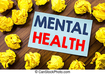Conceptual hand writing text inspiration showing Mental Health. Business concept for Anxiety Illness Disorder written on sticky note paper on the wooden background with folded yellow paper