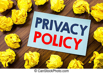 Conceptual hand writing text inspiration showing Privacy Policy. Business concept for Safety Data Rules written on sticky note paper on the wooden background with folded yellow paper