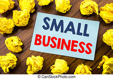 Conceptual hand writing text inspiration showing Small Business. Business concept for Strategy Management written on sticky note paper on the wooden background with folded yellow paper