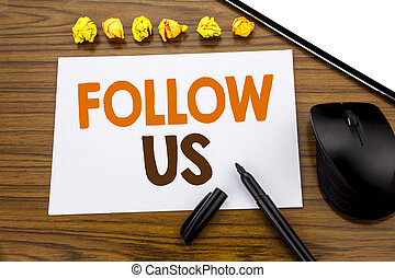 Conceptual hand writing text showing Follow Us. Business concept for Social Media Marketing written on sticky note paper on the wooden background with marker mouse and tablet office view.