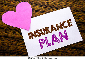 Conceptual hand writing text showing Insurance Plan. Concept for Health Life Insured written on sticky note paper, wooden wood background. With pink heart meaning love adoration.
