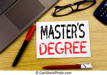 Conceptual hand writing text showing Master s Degree. Business concept for Academic Education written on paper, wooden background in office with copy space, marker pen and glasses