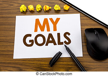 Conceptual hand writing text showing My Goals. Business concept for List Plan for Motivation written on sticky note paper on the wooden background with marker mouse and tablet office view.