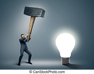 Conceptual image of a businessman holding huge hammer