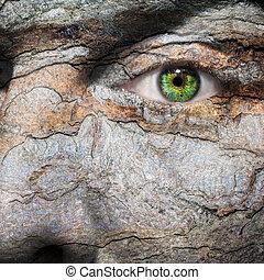 Conceptual image of a face with a bark skin - Conceptual...