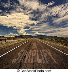 Conceptual image of desert road with the word simplify and arrow