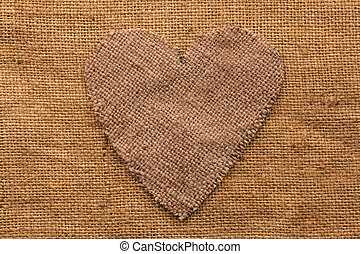 Conceptual image of the heart  lying on sackcloth