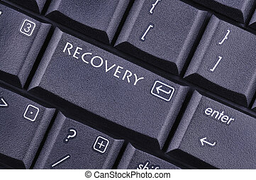 conceptual image of the recovery key on the computer keyboard