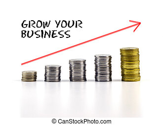 Conceptual image. Stacks of coins against white background with red arrow and GROW YOUR BUSINESS words.