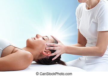 Conceptual osteopathic healing with light glow. - Close up...