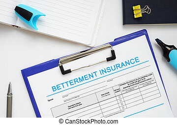Conceptual photo about BETTERMENT INSURANCE with handwritten text.