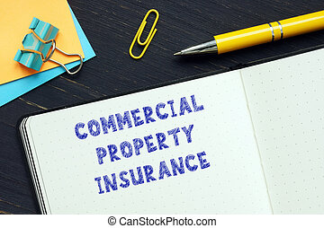 Conceptual photo about COMMERCIAL PROPERTY INSURANCE with handwritten text.