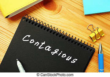 Conceptual photo about Contagious  with handwritten text.