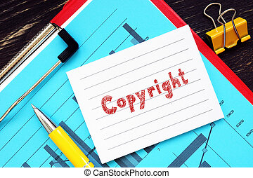 Conceptual photo about Copyright  with handwritten text.