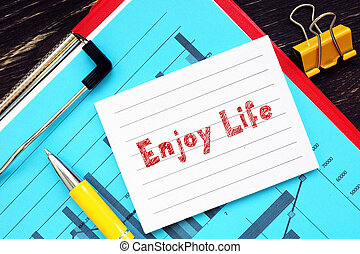 Conceptual photo about Enjoy Life  with handwritten text.