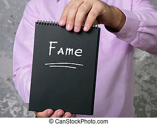 Conceptual photo about Fame with handwritten text.