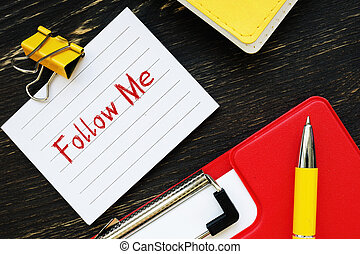 Conceptual photo about Follow Me  with handwritten text.