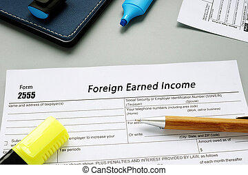 Conceptual photo about Form 2555 Foreign Earned Income with handwritten text.