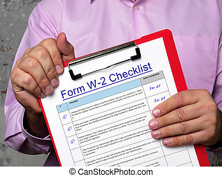 Conceptual photo about Form W-2 Checklist with handwritten phrase.