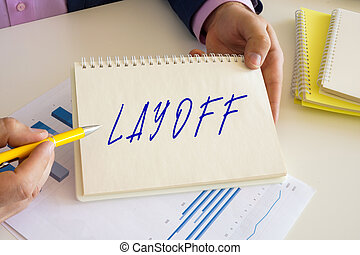 Conceptual photo about LAYOFF with handwritten text.