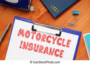 Conceptual photo about MOTORCYCLE INSURANCE with handwritten text.