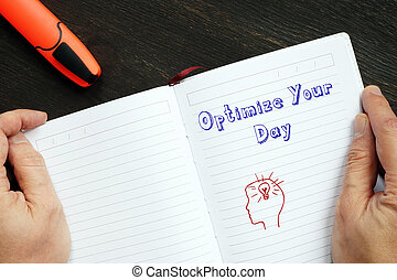 Conceptual photo about Optimize Your Day with handwritten text.