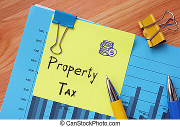 Conceptual photo about Property Tax with handwritten text.