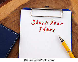 Conceptual photo about Share Your Ideas with handwritten text.