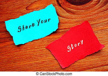 Conceptual photo about Share Your Story with handwritten text.