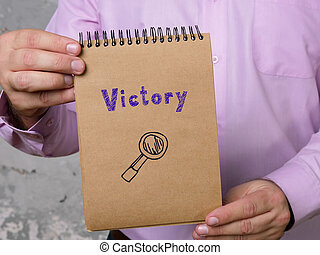 Conceptual photo about Victory with handwritten text.