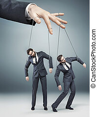 Conceptual photo of controlled employees