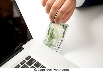 Conceptual photo of digital money transfer. Man inserting...