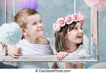 Conceptual photo of kids holdng a photo frame