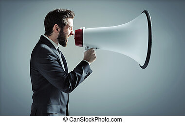 Conceptual photo of man yelling over the megaphone