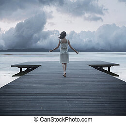 Conceptual photo of the lady on the jetty - Conceptual photo...