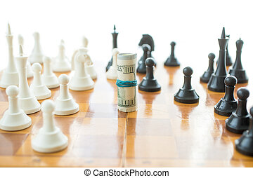 Conceptual photo of twisted money on wooden chessboard -...