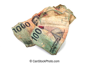 Conceptual photo of two dirty Indonesian banknotes isolated...