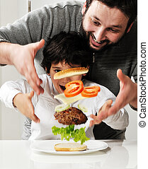 Conceptual photography - flying ingredients of hamburger.